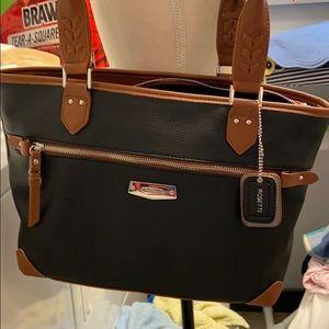 Rosetti black trimmed in brown purse.